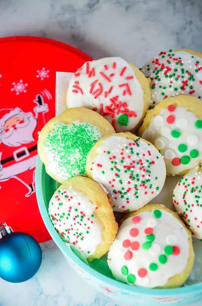 These Italian Ricotta Cookies are soft and light and a holiday favorite at my house! Lightly lemon flavored and decked out in holiday sprinkles, no Christmas cookie tray is complete without these!