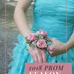 Girl in teal prom dress adusting corsage