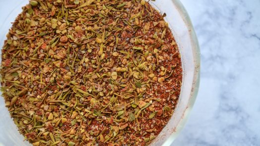 Small bowl of Dinosaur Bar-B-Que Creole Seasoning Blend Recipe on marble background