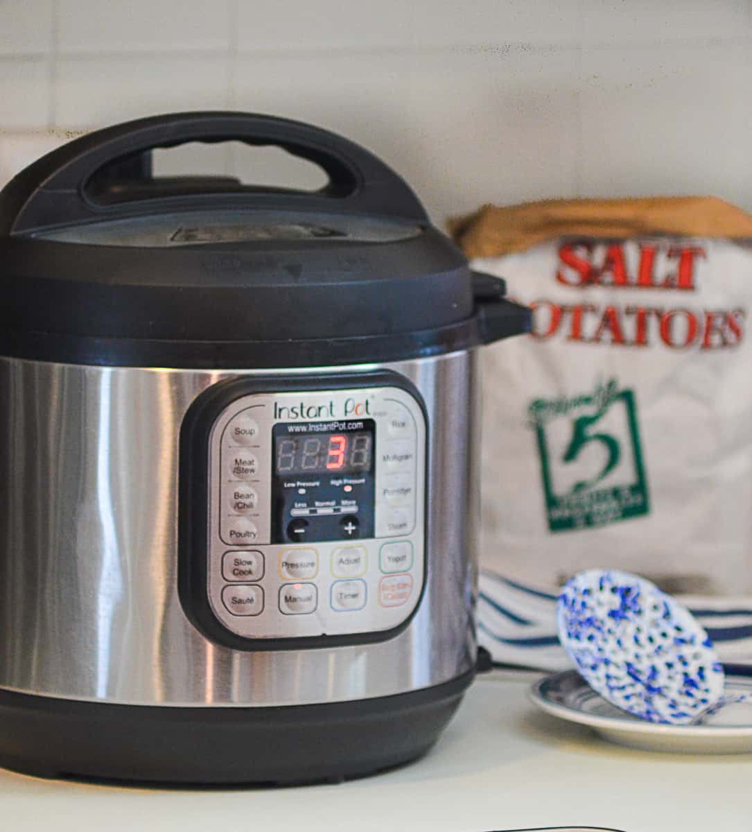 An Instant Pot ona kitchen counter top,  set for 3 minutes high pressure to cook Syracuse Salt Potatoes